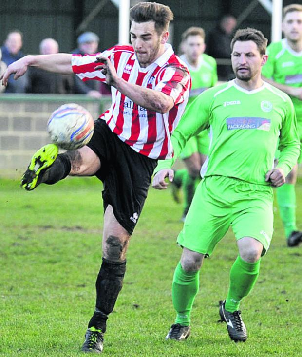 The Wiltshire Gazette and Herald: Devizes Town's Jamie McLaughlin in possession during his side's defeat to Westbury United on Saturday