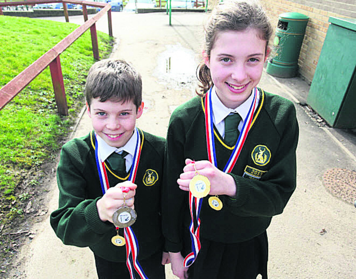 Conor Irwin and sister Ciara, with their medals