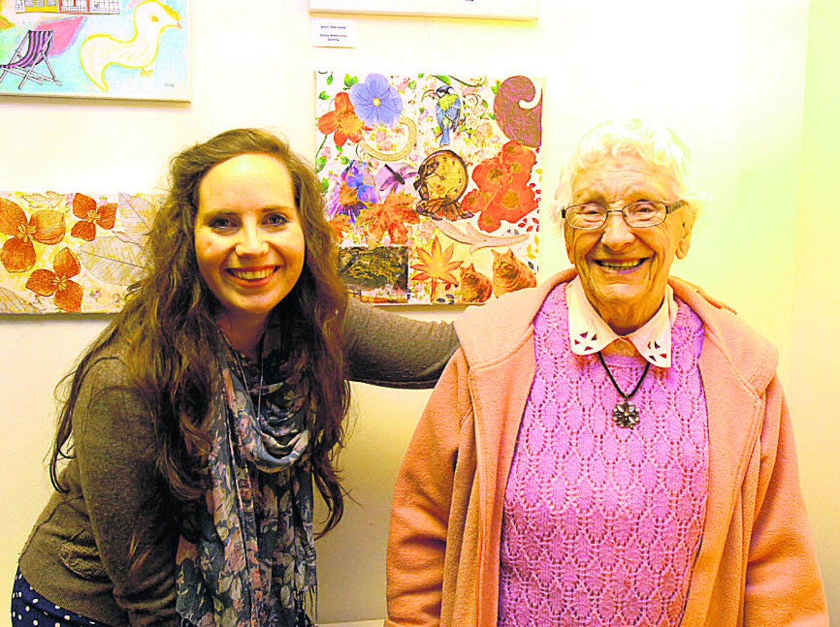 Art teacher Emma Burbidge with 94-year-old Vera Wardell and some of the artwork, which is on display at Pewsey Gallery this month