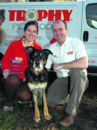 Award-winning Trophy Pet Foods franchisees Matthew and Jenny Snell with their ageing mongrel dog, Morse