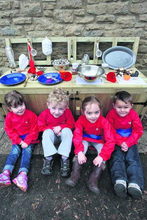 Crudwell Pre-School youngsters Sophia, Aidan, Sasha and Jaq show off their new mud kitchen