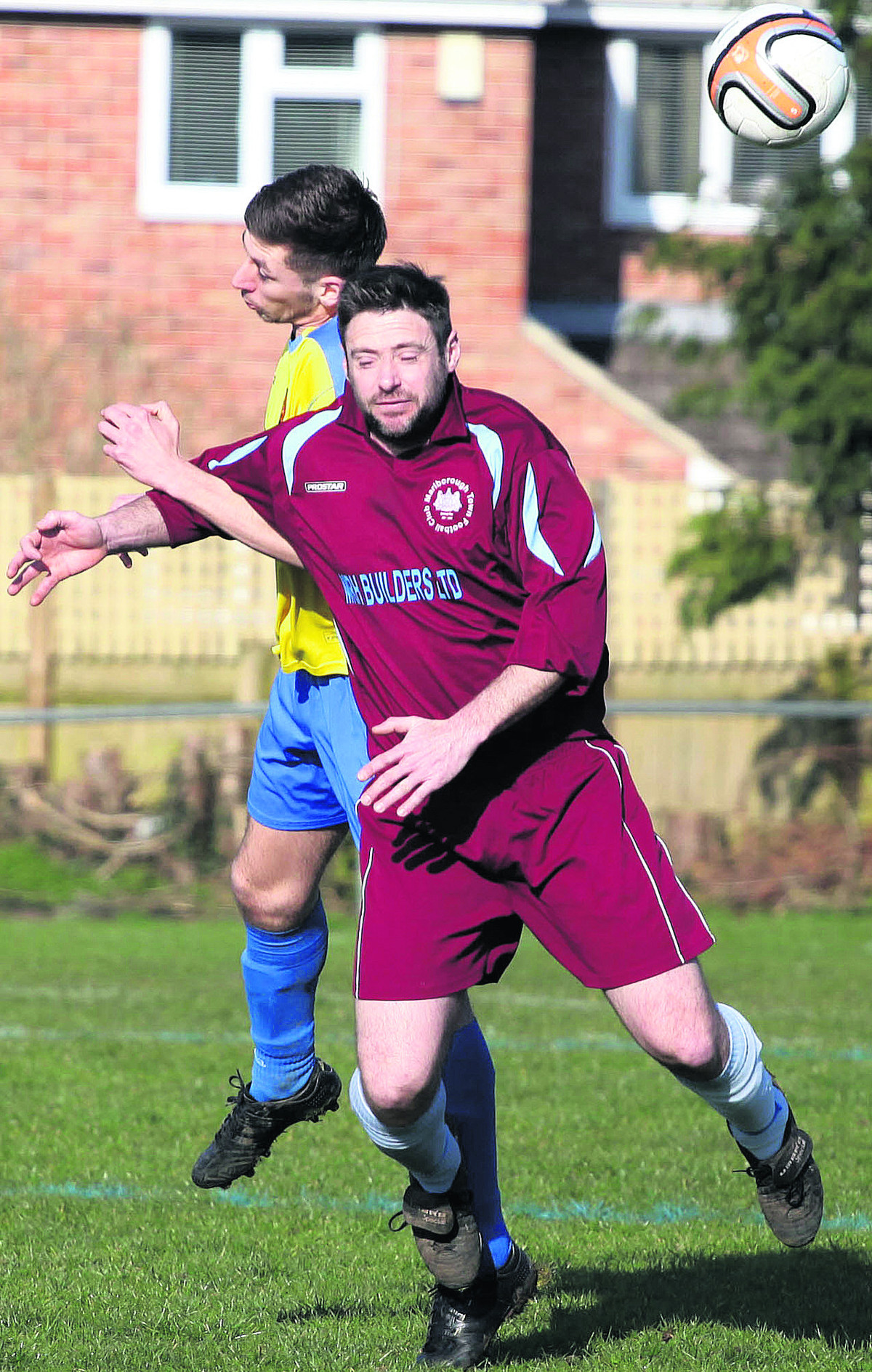 Marlborough Town's Leigh Blanchard (burgundy) challenges Corsham Town Reserves' Josh Batstone in the air during Saturday's Wiltshire League Premier Division clash