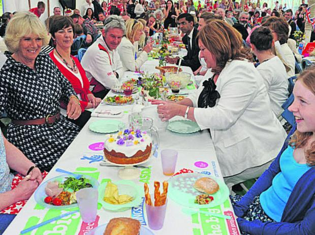 The Wiltshire Gazette and Herald: The Duchess of Cornwall enjoys the Big Lunch at Paxcroft Mead, Trowbridge, last year