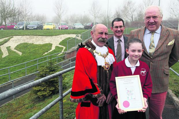 Harriet Dennis, of Nursteed Community Primary School, receiving her prize from Devizes mayor, Pete Smith, with head teacher Tim Heath and governor John Parker       (VS232) By VICKY SCIPIO