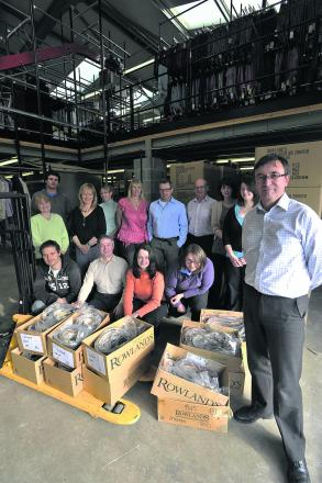 Director David Selby pictured with staff at the Southwick warehouse at the time of the 2012 buy-out