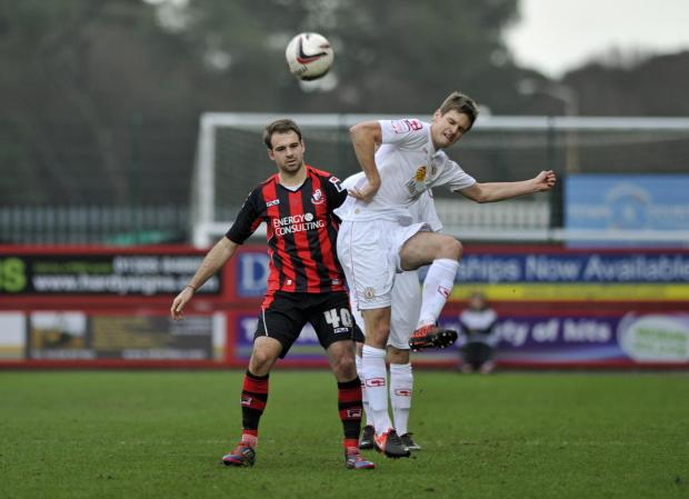 Jon Guthrie (right) has signed a new deal with Crewe Alexandra