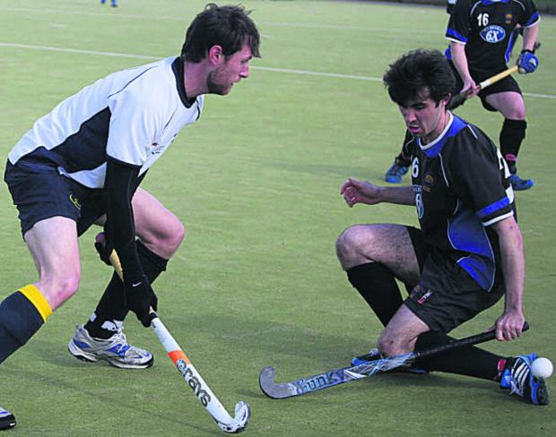 Devizes' Callum Lavens (right) tries to block the progress of Team Bath's Rich Warwick during his side's 6-1 victory on Saturday that wrapped up promotion from Davis Wood League Central One
