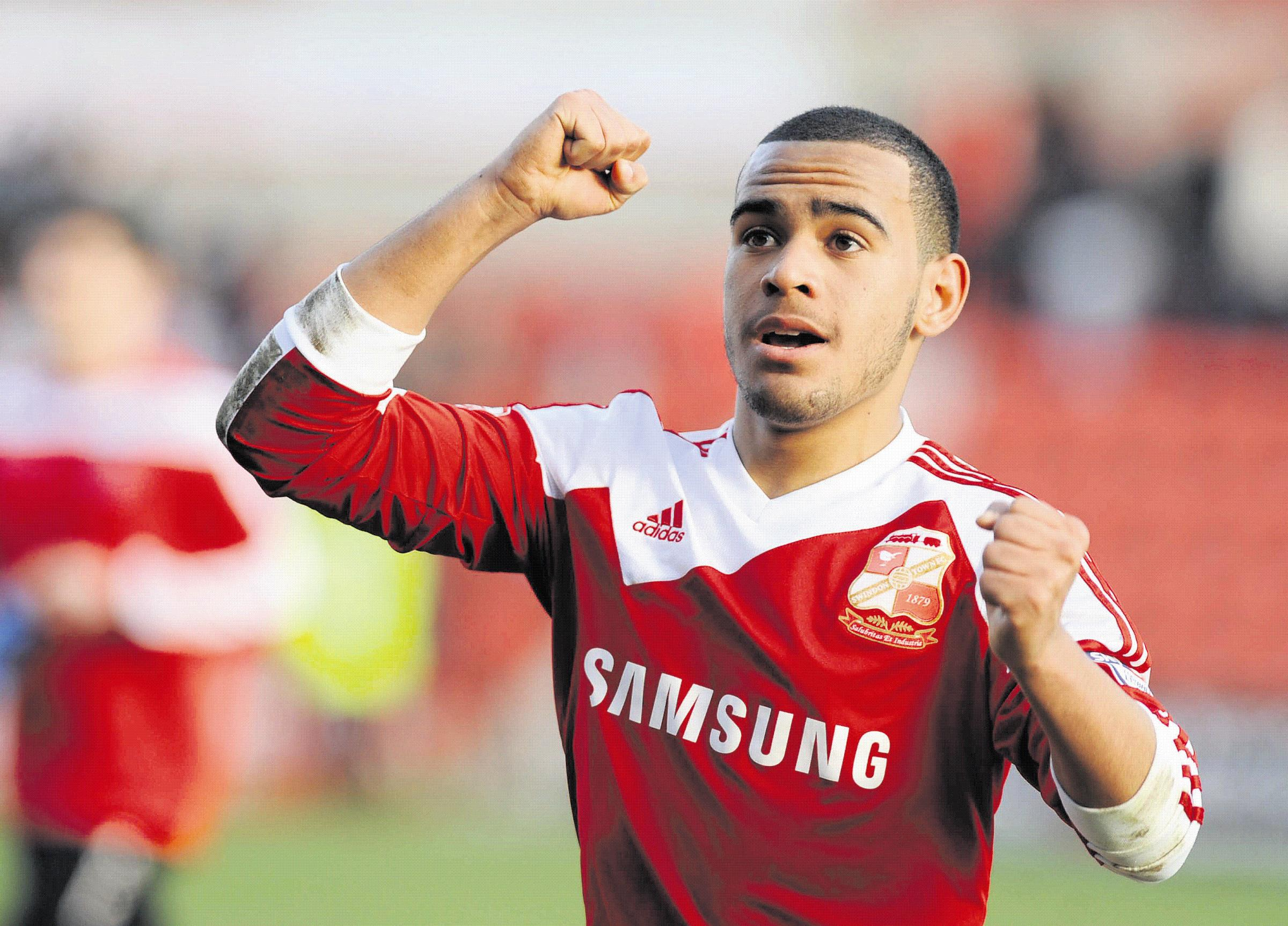 Louis Thompson is focused on life at Swindon Town despite reported interested from elsewhere