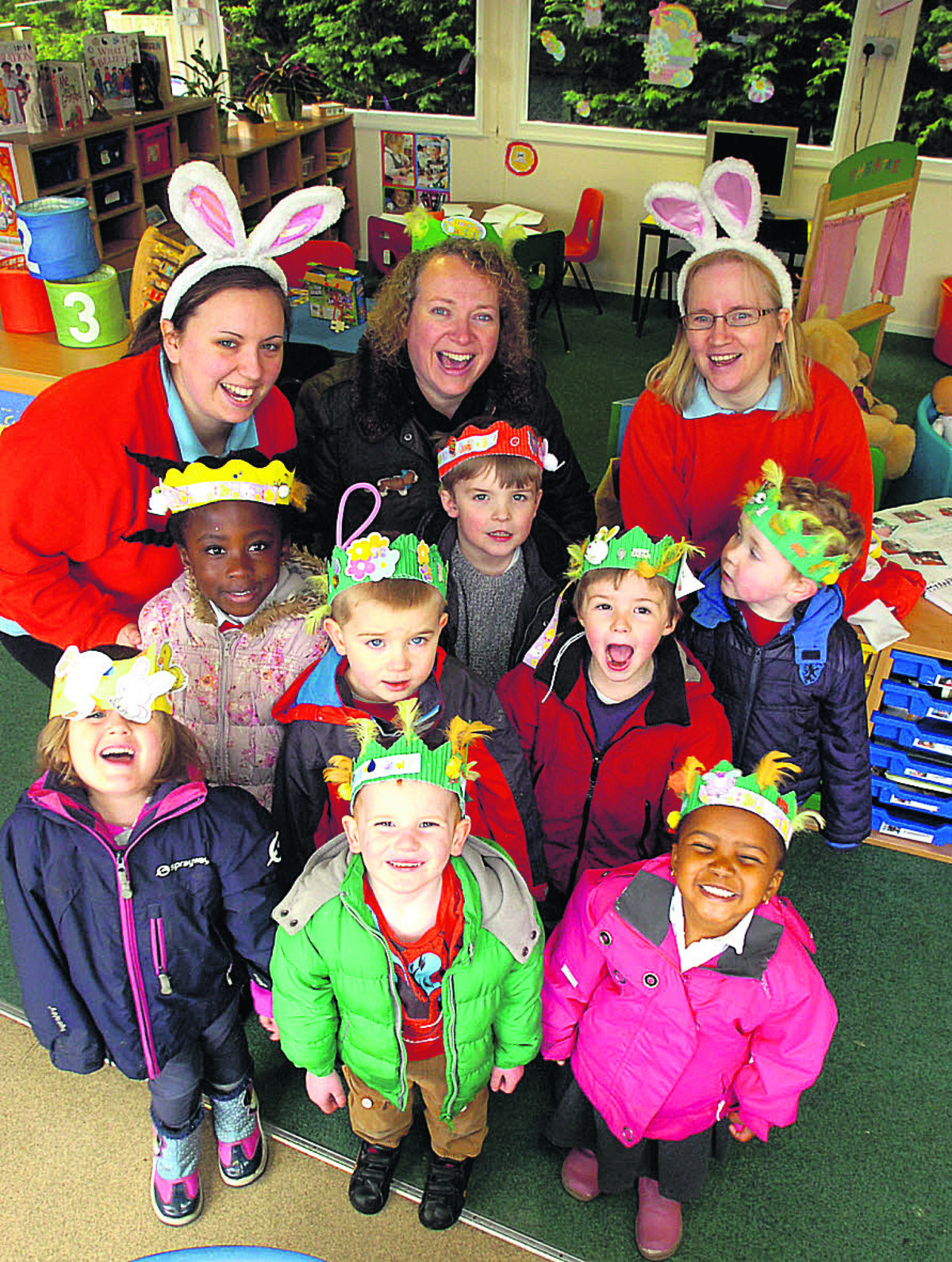 Pupils at Sunny Days Pre-school in Lyneham made Easter  bonnets. Pictured are Sam Taylor, Jean Rimmer and Martine Campbell with children and their bonnets