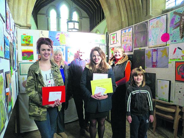 Prize winners Lily Shergold, Katie Sims and Emily Rees with judges Flora Rudd, Jeff Meddings and Val Craig