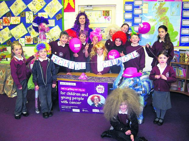 The Wiltshire Gazette and Herald: Children at Rushall Primary School sport colourful wigs to raise money for charity