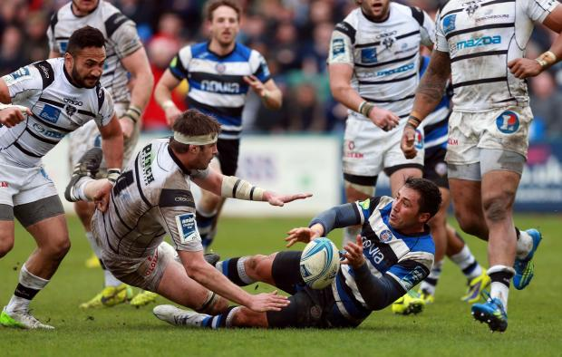 The Wiltshire Gazette and Herald: Gavin Henson is tackled during today's quarter final