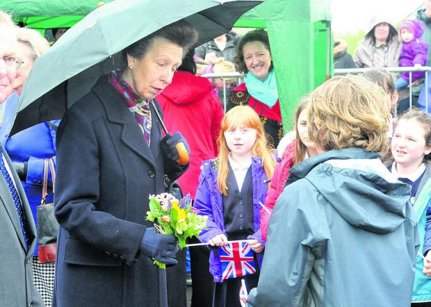 The Wiltshire Gazette and Herald: Princess Anne receives flowers from children during her visit to Devizes this morning