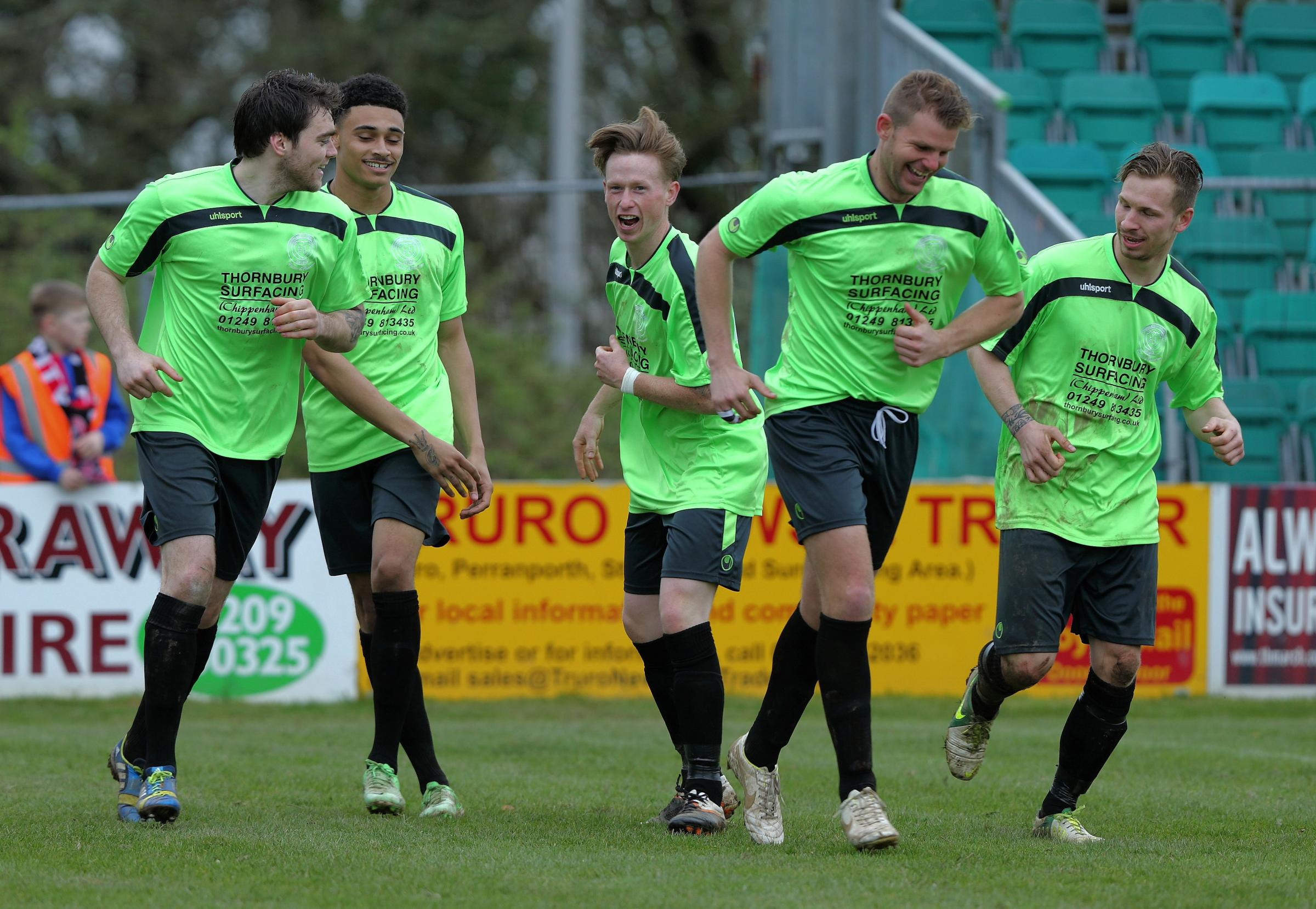Chippenham Town's players celebrate after Corey King (second from left) puts them ahead during last weekend's 3-1 win at Truro City (Picture: Chippenham Town FC)