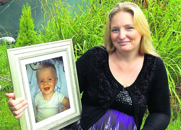 Kelly Pritchard with a portrait  of her son, Alfie-Ray
