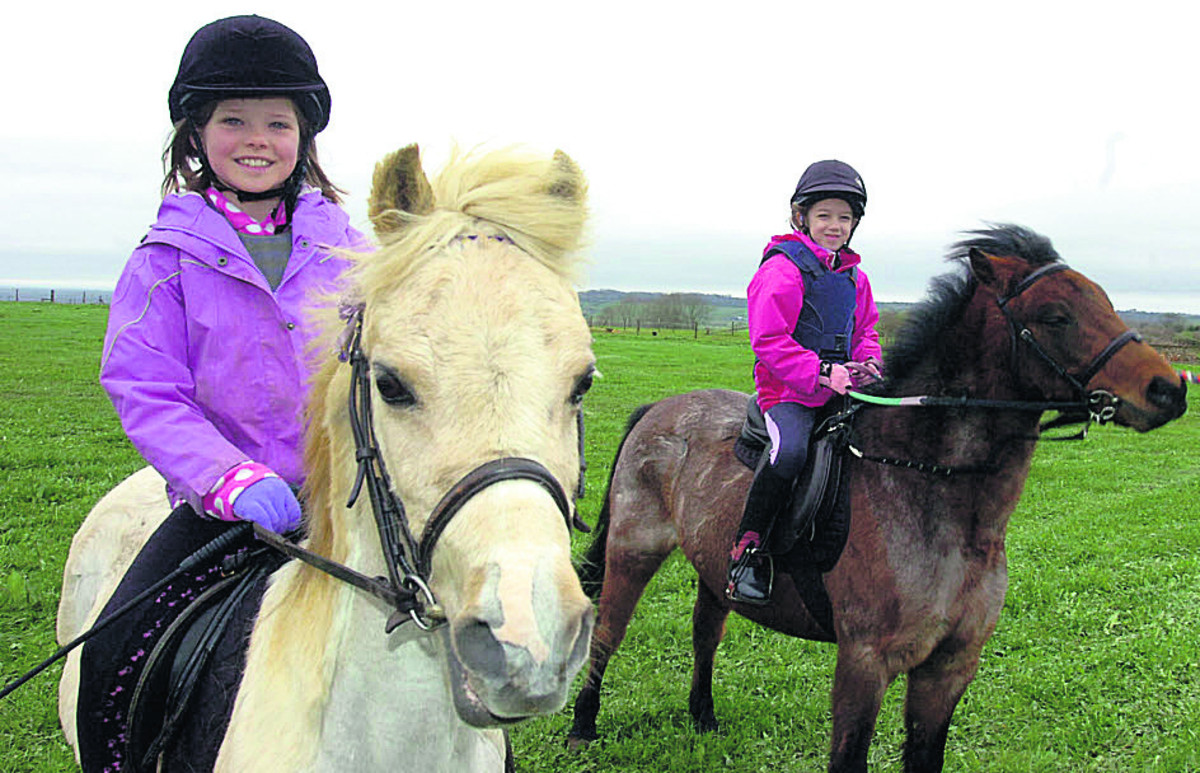 Riders Elouise Webb with Devon and Abigale Wood with Woody