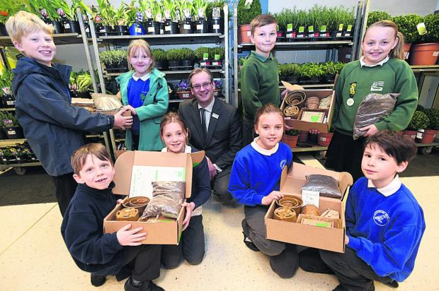 Marlborough area children from Ogbourne, Burbage, Pewsey and Ramsbury schools with Waitrose's department manager, Charles Bentley, and their seed growing kits for summer produce