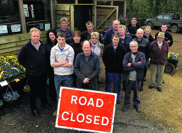 Lyneham Farm Shop owner Tim Webb, front centre, with business people and residents unhappy with road closures caused by the shutting of Dauntsey Lock railway bridge