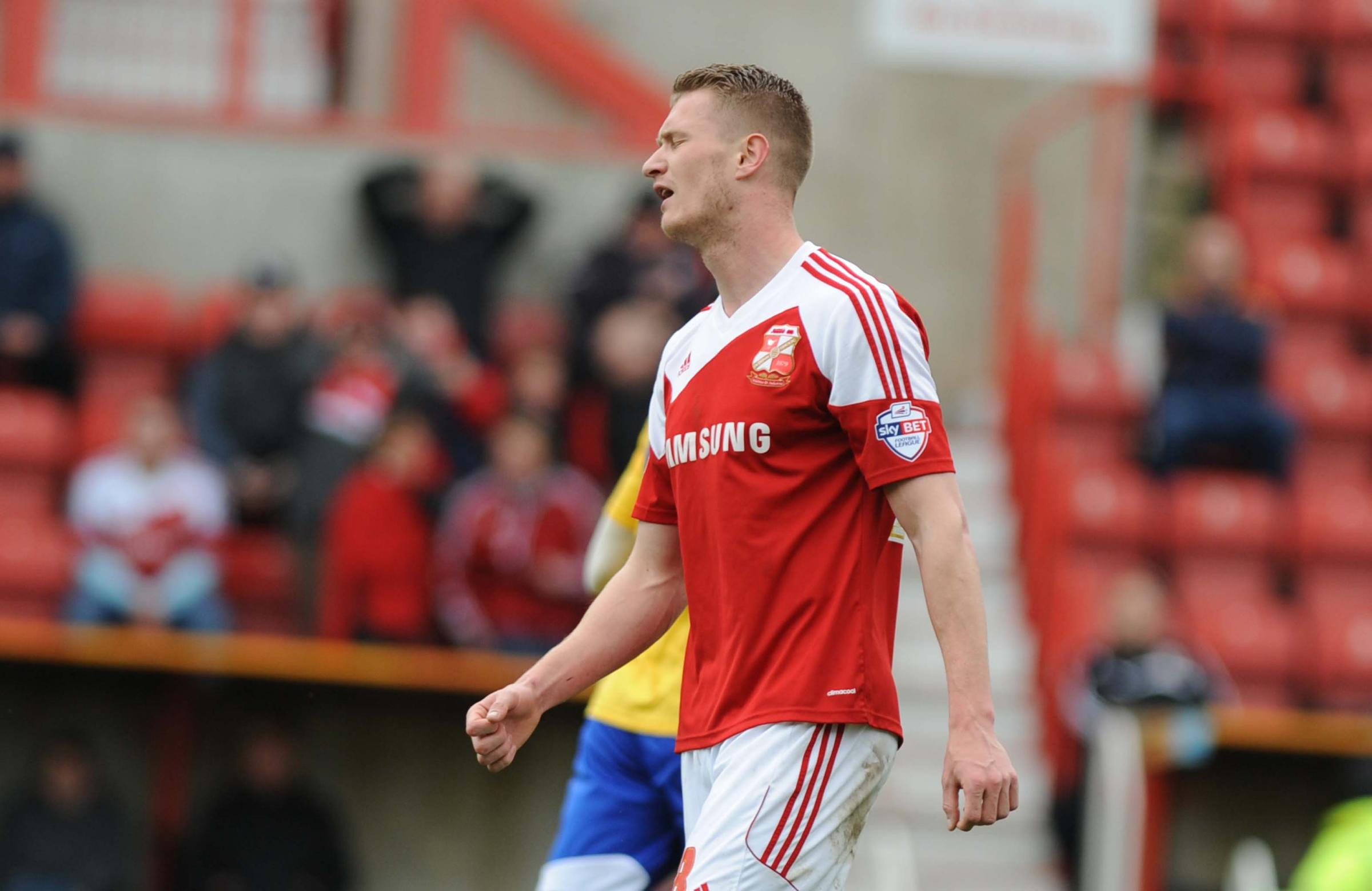 Michael Smith rues his penalty miss during Swindon Town's 1-0 victory over Brentford on Saturday