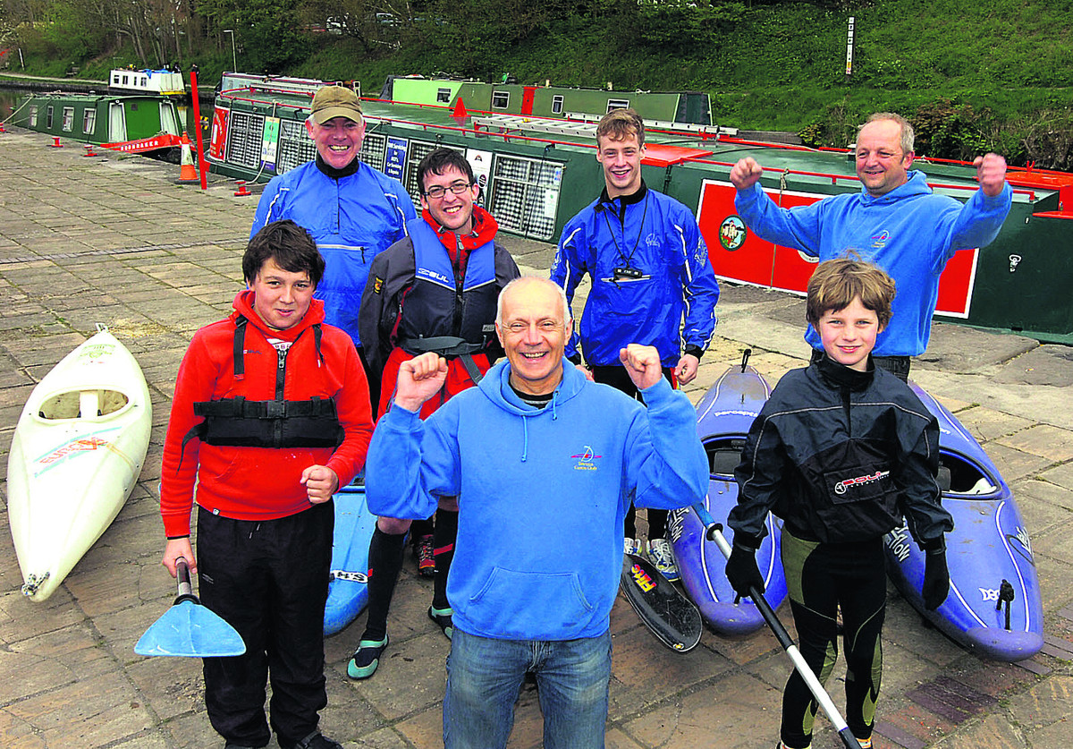 Canoe Club vice chairman Mark Bouch celebrates news of the windfall with canoe club members