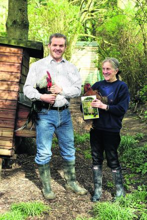 Martin and Anne Perdeaux with two of their chickens at home in Upavon           (DV1240) PICTURE BY DIANE VOSE