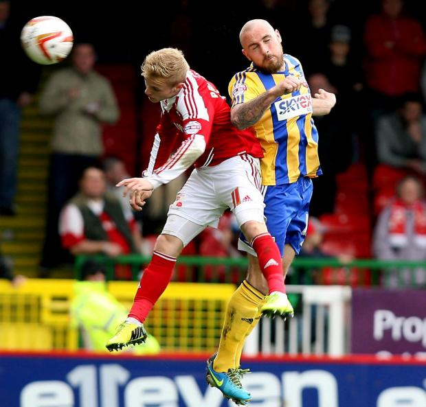 The Wiltshire Gazette and Herald: Alex Pritchard tussles with former Swindon Town captain Alan McCormack in the match against Brentford on Saturday. Picture: Terry Parker