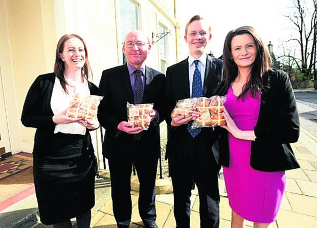 The Wiltshire Gazette and Herald: Staff at Forrester Sylvester Mackett Solicitors, from left, Hannah While, Richard Coates, Jonathan Watts and Helen While with their free hot cross buns                               (DV1245)