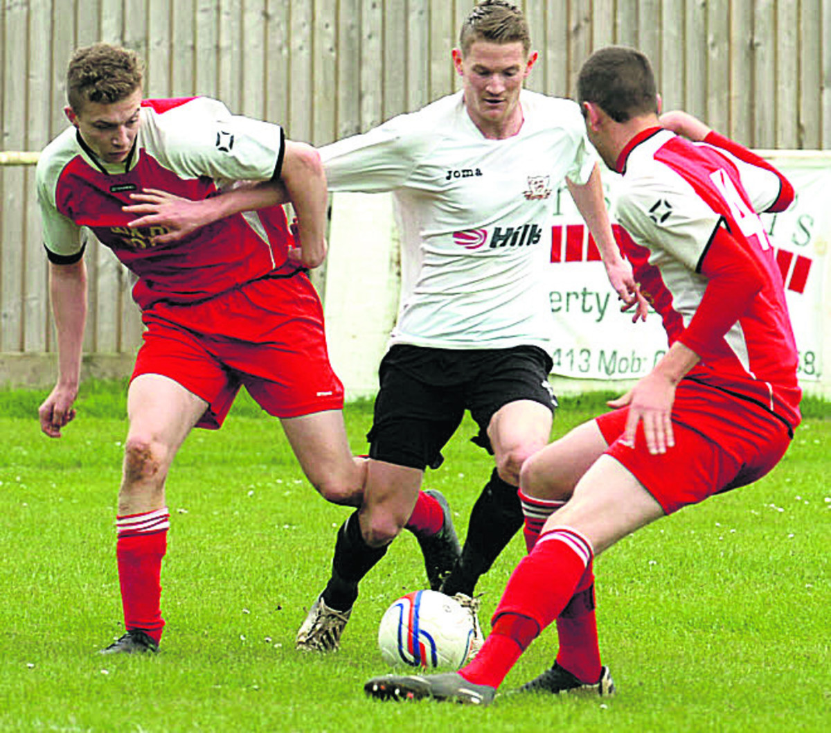 Calne's Aaron Hopkins tries to weave through the Corsham defence during last Satruday's derby
