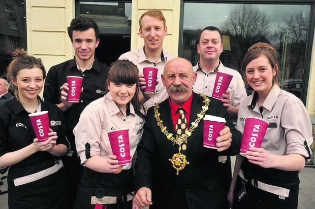 Market Place Costa staff with Devizes mayor Pete Smith and manager Matt Coulthard, right of the mayor  (VS289) By VICKY SCIPIO
