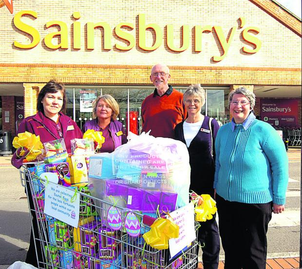 Pictured with the Easter eggs are Kathryn Seviour, Serena McKendrick, of Sainsbury's, Keith Coates, of the food bank, and Margaret Boyd, and Rose Hewer from the Salvation Army                                                                    (PM1179) b