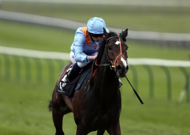 Toormore ridden by Ryan Moore on their way to victory in the Novae Bloodstock Insurance Craven Stakes at Newmarket yesterday