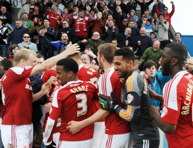 Swindon Town celebrate Michael Smith's late winner against Coventry