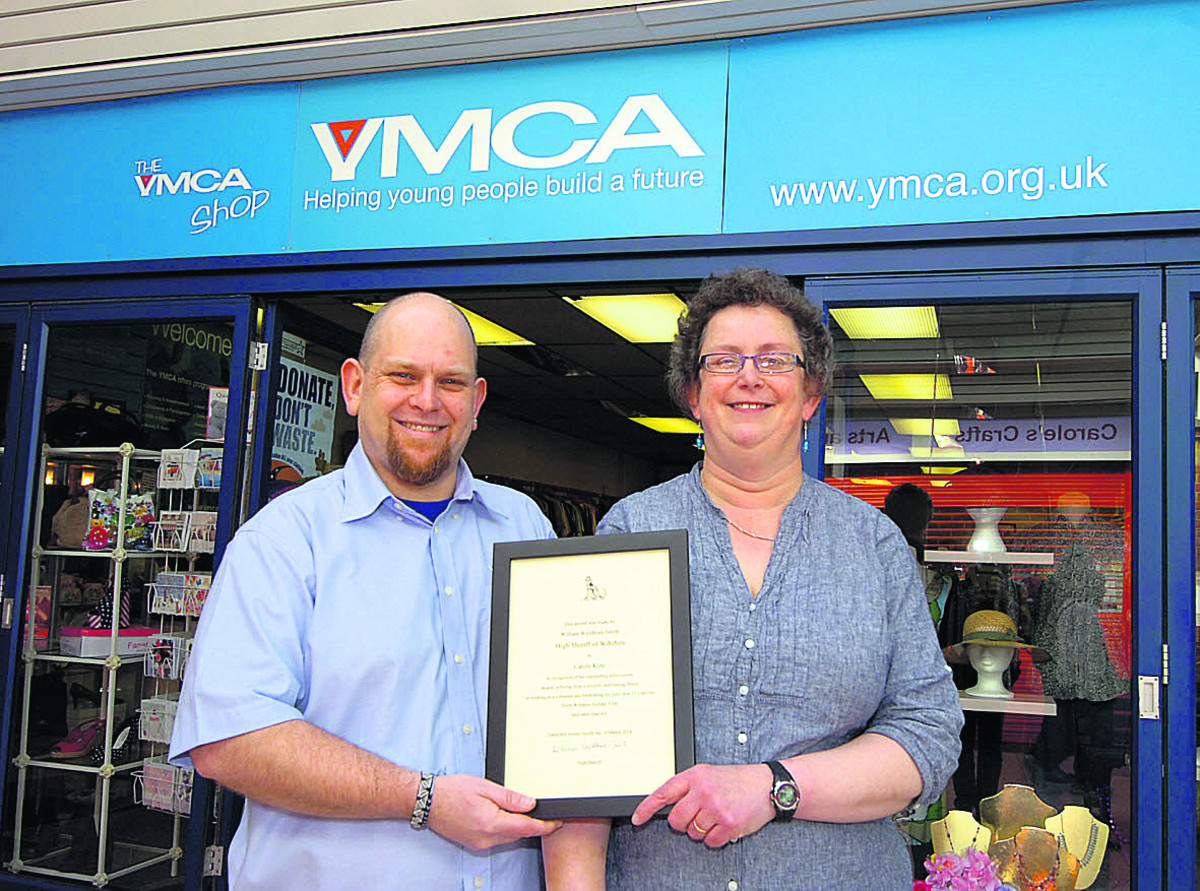 Carole Kyte with manager Steve Graham and the high sheriff's award