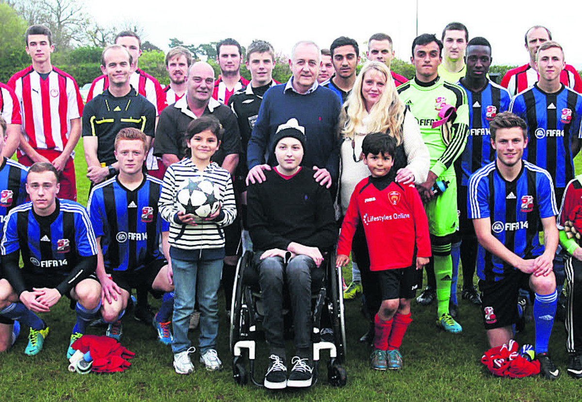 Ben Conolly (centre) surrounded by football players, supporters and his family