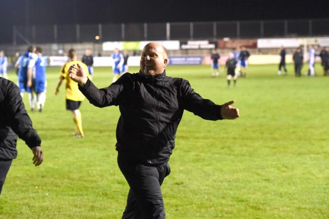 Melksham Town manager Darren Perrin celebrates his side's Wiltshire Senior Cup triumph in 2014