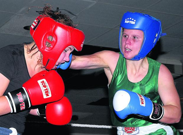 Emeralds' Emma Hanselman (above, green) has Swindon opponent Bronwyn Duff on the ropes on her way to her first career victory Picture by Paul Mazzotta