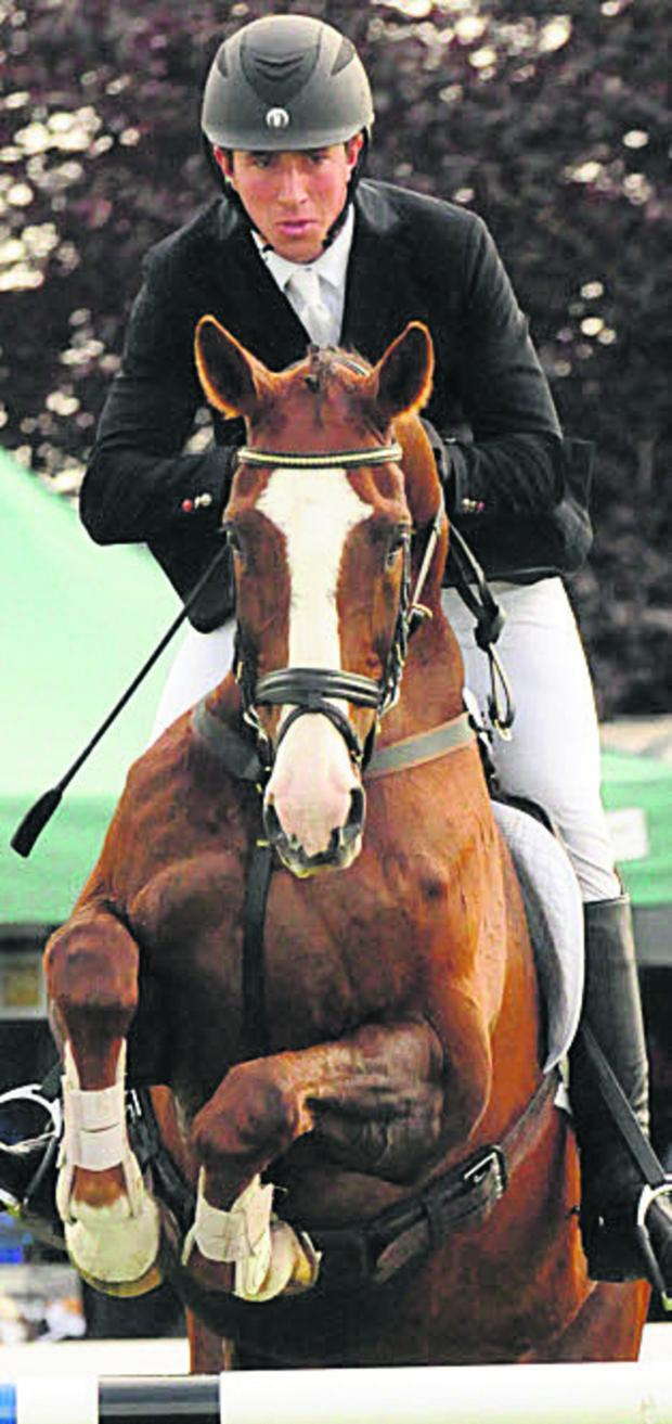 The Wiltshire Gazette and Herald: David Doel rides Koyuna Sun Magic at the Kelsall Horse Trials