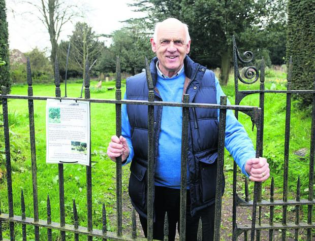 The Wiltshire Gazette and Herald: Councillor Stewart Dobson uncovered a hidden grave bearing his family name during a community clear-up project in Marlborough's old cemetery. (VS309) By Vicky Scipio
