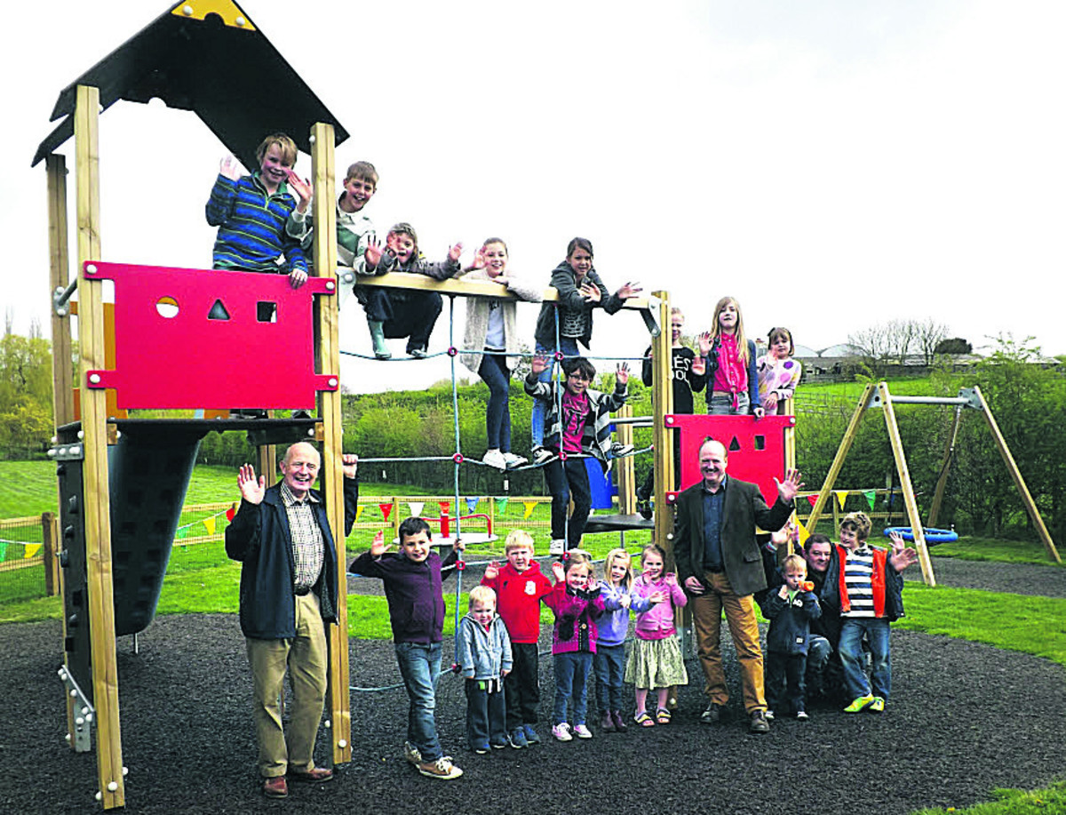 Coun Philip Whitehead, right, opens the Easterton play area with village children a