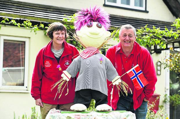 Ros Pendry and chairman Rob Pendry with a scarecrow they have made for the festival 								 (DV1279) By DIANE VOSE