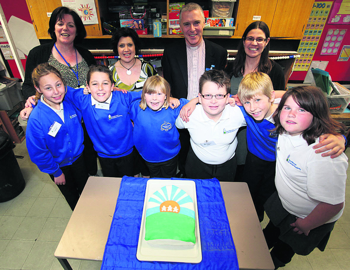 From left, teaching assistant Dawn Ward, PSA co-chairman Debbie Morris, the Rev Jonathan Triffitt and PSA secretary Dawn Gregory with pupils                 (VS323) By Vicky Scipio