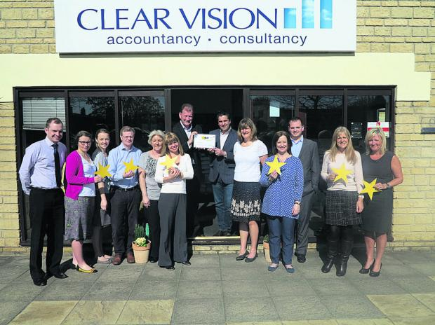 Accountancy firm Clear Vision has attained the highest rating for customer service. Managing director Rob Walsh is in the centre on the left, with director Matthew Rogers on the right