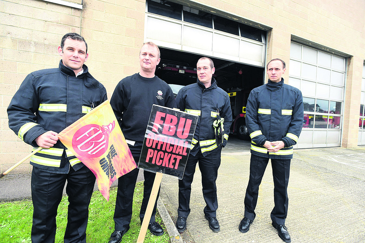 Manning the picket line outside Chippenham Fire Station in May were Watch Manager Paul Hanlon and firefighters Rob Ky