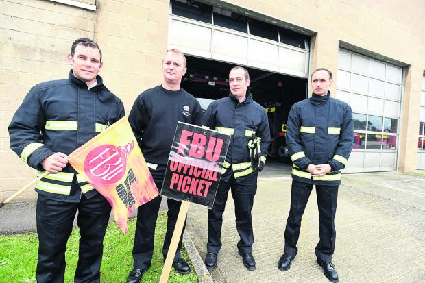 The Wiltshire Gazette and Herald: Manning the picket line outside Chippenham Fire Station in May were Watch Manager Paul Hanlon and firefighters Rob Kymoch, Colin Tailby and Paul Peche
