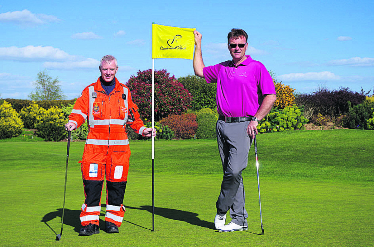 Steve Riddle, Wiltshire Air Ambulance paramedic, and John Jacobs, head professional at Cumberwell Park Golf Club, prepare for the charity golf day on September 19