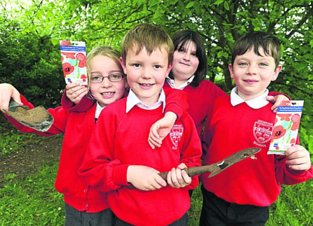 Ruby, Ben, Hollie and Lewis, of St Nicholas School in Bromham, ready to plant poppy seeds seeds. (DV1288) Picture by Diane Vose