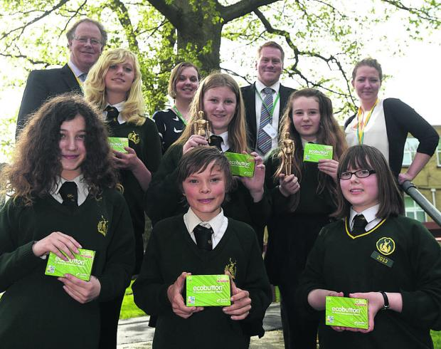 From front left are Maddy, Wilf and Lauren, middle are Lucy, Tabitha and Bella, and back are Coun Toby Sturgis, maths teacher Ruth Steward, assistant deputy headteacher David Clarke, and Wiltshire Council's green team project officer Jenny Watson