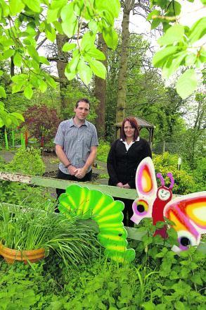 Deputy manager Brandon Yorke with Michelle Harris, a friend of Canon's House, in the garden                  (PM1219) By Paul Morris