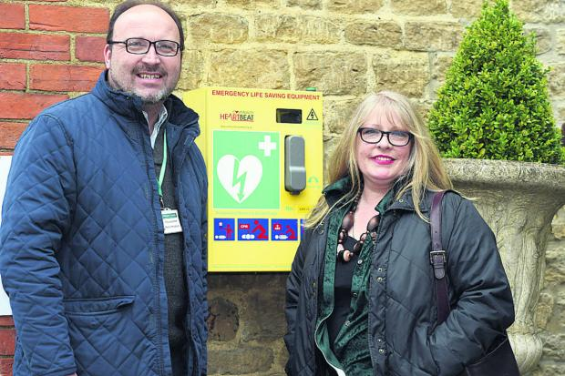 Coun Peter Hutton with Alison Butler next to the defibrillator at The Jolly Huntsman in Kington St Michael                                                                                                         (DV1265) By Diane Vose