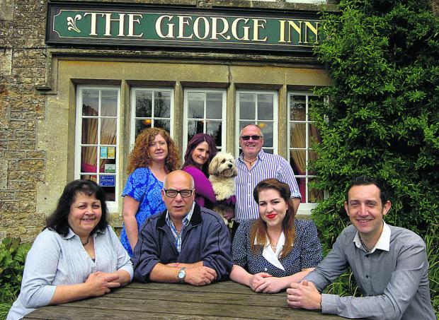 From front left are Raff Weaver, Colin Weaver, Erin Weaver and Jonathon Russell, the new team at the pub. Harriet Jenkinson, Cara Jenkinson, Mark Jenkinson and dog Jasmin, at the back, have handed over the reins                                 (PM1213) By